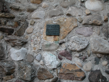 Wall with insignia